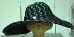 ポリエステル製のつば広帽、57Cmで\1200です。